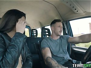 sexy dark haired deep-throating spear in the car