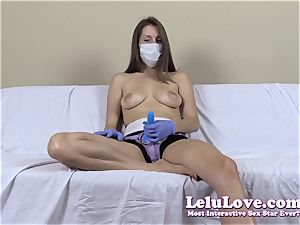 sans bra woman with medical mask and strap on dildo