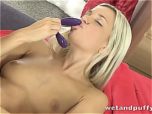 stunner in milky stocking caresses herself with fake penis