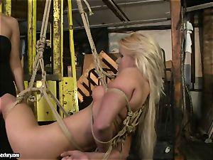 Mandy Bright bound a warm platinum-blonde with strap