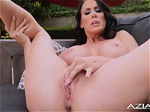 handsome cougar Reagan Fox thumbs her moist twat outdoors
