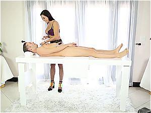 beautiful masseuse tugging timid dude